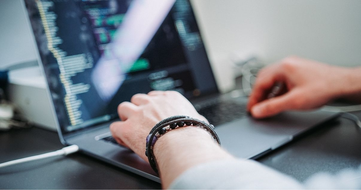 Software engineer developing on his laptop